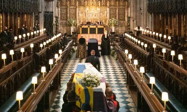The coffin of the Duke of Edinburgh is carried into The Quire during his funeral service at St George's Chapel, Windsor Castle, Berkshire