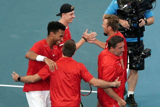 Felix Auger-Aliassime and Denis Shapovalov of Canada celebrate with their team after winning their doubles match against Germany during day 5 of the ATP Cup tennis tournament at Pat Rafter Arena in Brisbane