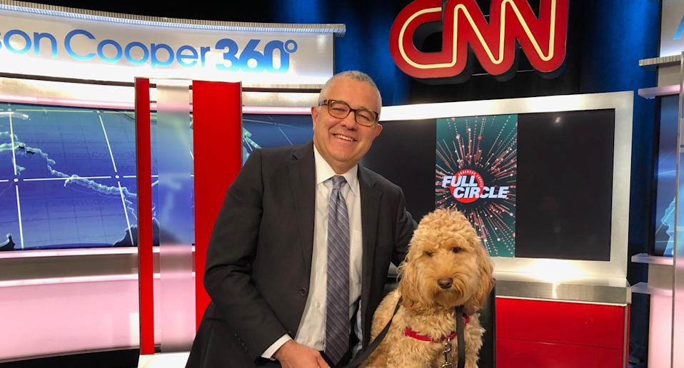 Jeffrey Toobin pictured on the CNN set with his dog.