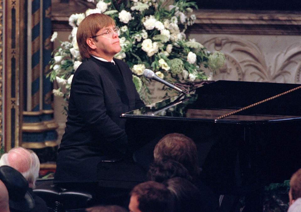 """**  FILE  **  Elton John plays a specially re-written version of his song """"Candle in the Wind"""" during the funeral service for Diana, Princess of Wales at London's Westminster Abbey in this Saturday, Sept. 6, 1997 file photo. (AP Photo/Paul Hackett, Pool)"""