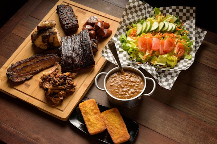 Guy Fieri declares barbecue authentic at Fat Daddy's Smokehouse in Maui.