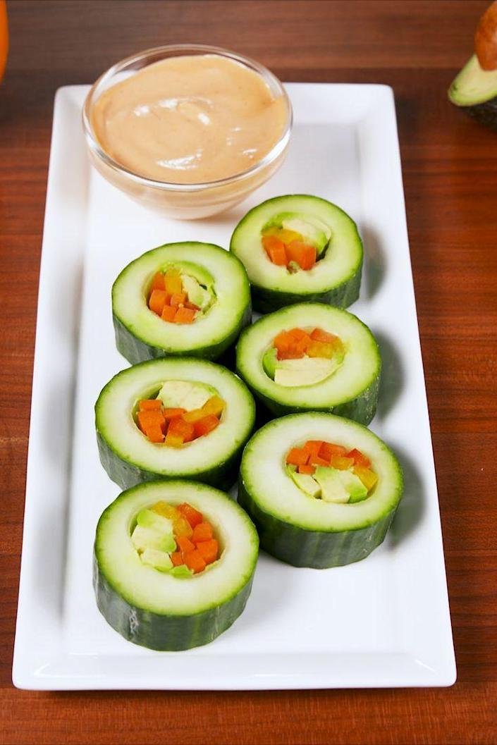 """<p>We know it's not real sushi but we love it just the same.</p><p>Get the recipe from <a href=""""https://www.delish.com/cooking/recipe-ideas/recipes/a58629/cucumber-sushi-recipe/"""" rel=""""nofollow noopener"""" target=""""_blank"""" data-ylk=""""slk:Delish"""" class=""""link rapid-noclick-resp"""">Delish</a>. </p>"""