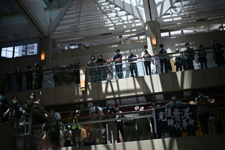 Hong Kong Police Spray Tear Gas at Protest in Shopping Mall