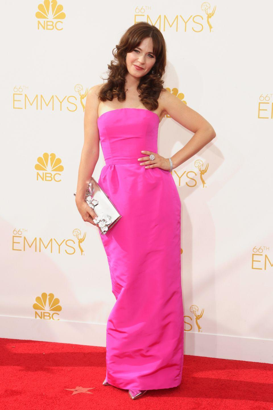 <p>Zooey Deschanel looked like a present-day Princess Aurora in a shocking pink Oscar de la Renta gown at the 2014 Emmy Awards.</p>