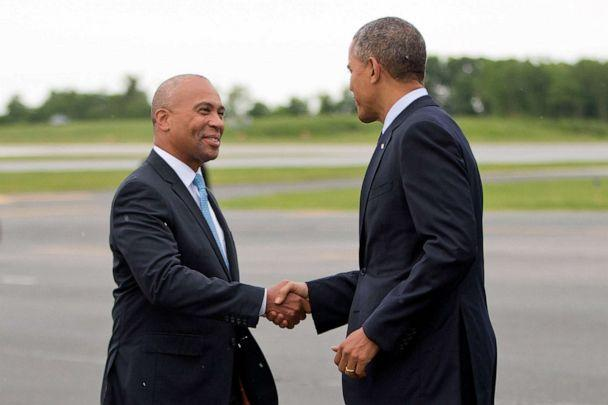 PHOTO: In this June 11, 2014, file photo, President Barack Obama is greeted by then-Massachusetts Gov. Deval Patrick, upon his arrival at Worcester Regional Airport in Worcester, Mass. (Pablo Martinez Monsivais/AP)