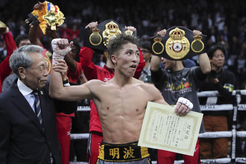 Japan's Naoya Inoue is congratulated after winning the World Boxing Super Series bantamweight final match in Saitama, Japan, Thursday, Nov. 7, 2019. Inoue beat Philippines' Nonito Donaire with a unanimous decision to win the championship. (AP Photo/Toru Takahashi)