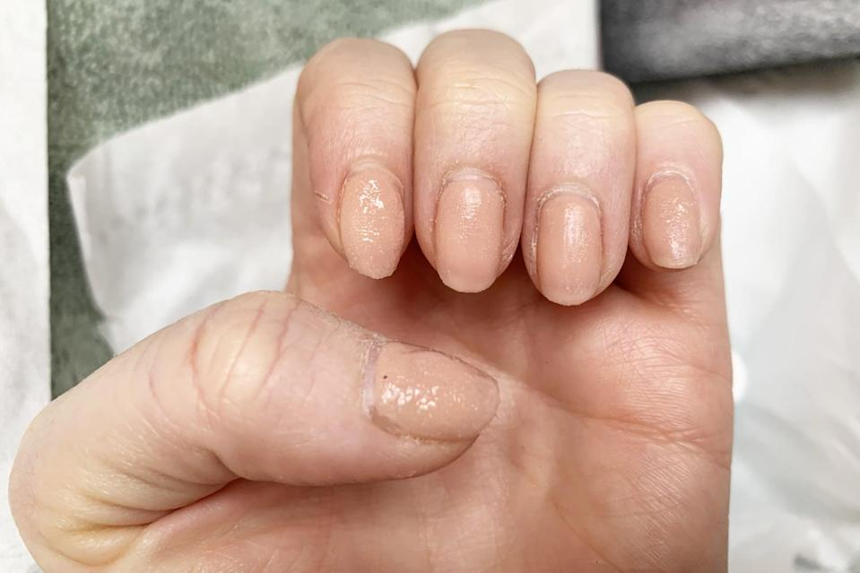 <p>The remover is a goopy, clear liquid, and I piled it on with the little brush. No water is needed.</p>