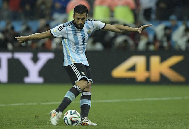 Argentina's defender Ezequiel Garay takes a shot during penalty shoot-outs following extra time during the 2014 FIFA World Cup semi-final match against Netherlands at the Corinthians Arena in Sao Paulo on July 9, 2014 (AFP Photo/Juan Mabromata)