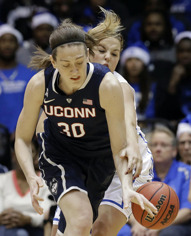 Connecticut's Breanna Stewart, left, and Duke's Tricia Liston, right, reach for the ball during the first half of an NCAA college basketball game in Durham, N.C., Tuesday, Dec. 17, 2013. (AP Photo/Gerry Broome)