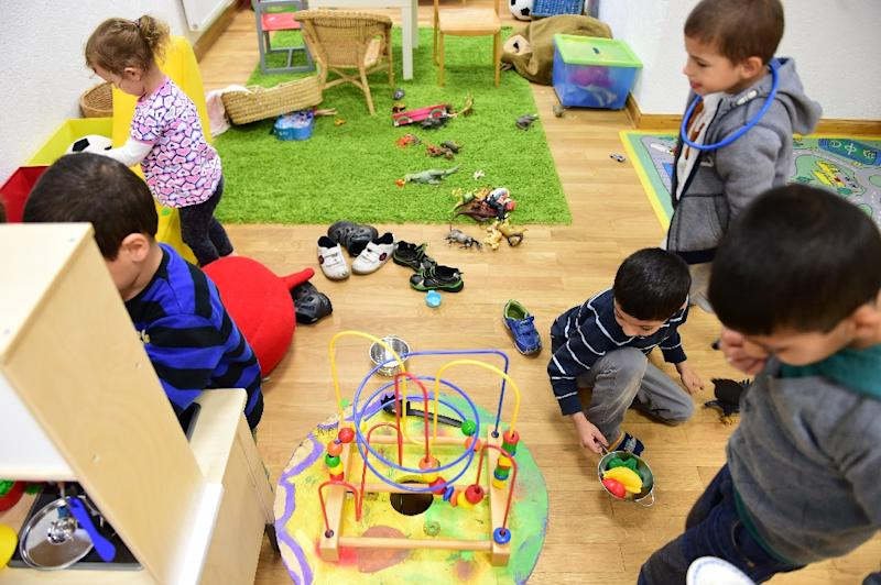 Children play at a day-care centre in the Georg Kriedte Haus home for migrants in Berlin on October 8, 2015