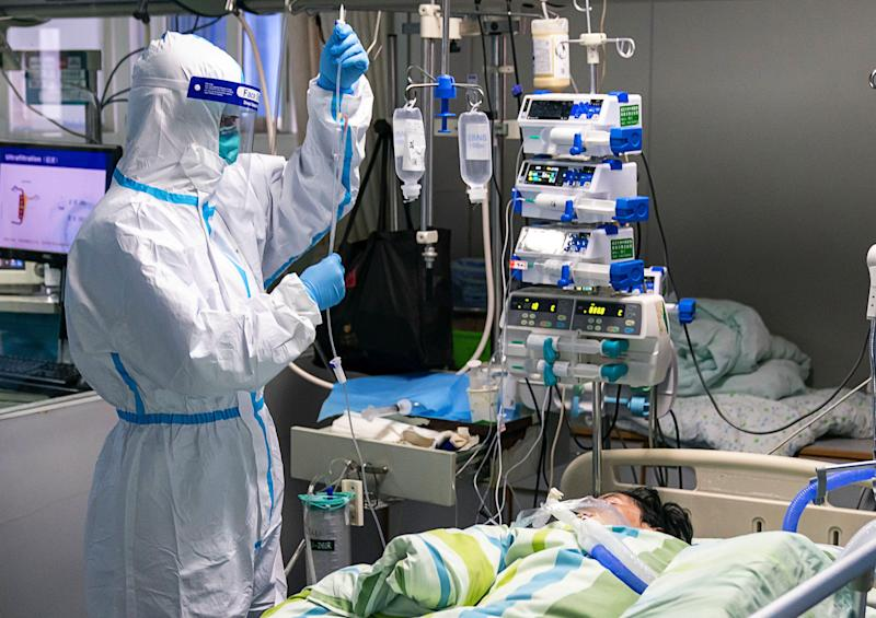 A medical worker checking the drip of a patient in the Intensive Care Unit (ICU) of Zhongnan Hospital of Wuhan University in Wuhan, where the virus is thought to have begun. Source: AAP