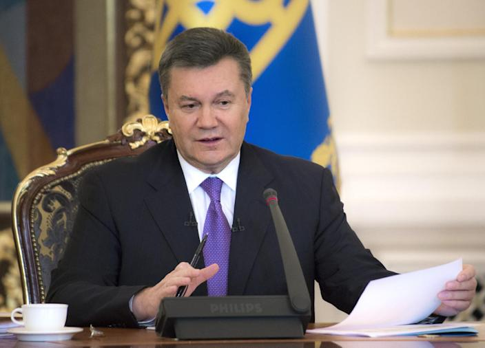FILE - In this Thursday, Dec. 19, 2013 file photo Ukrainian President Viktor Yanukovych speaks during a press conference in Kiev, Ukraine. Ukraine's embattled president Viktor Yanukovych is taking sick leave on Thursday, Jan. 30, 2014, as the country's political crisis continues without signs of resolution. A statement on the presidential website Thursday said Yanukovych has an acute respiratory illness and high fever. There was no indication of how long he might be on leave or whether he would be able to do any work. (AP Photo/Mykhailo Markiv, Pool)