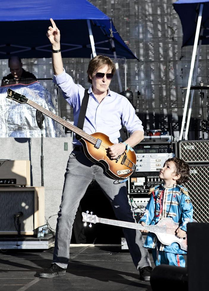 In this handout photo of Sir Paul McCartney with Ichiro who is dressed in his own Sgt Peppers outfit, on stage during a sound check ahead of his concert in Montevideo, Uruguay, Monday, April 16, 2012. The two year old boy had traveled with his parents all the way from Argentina and made himself known to the security team and was invited up on stage by Sir Paul himself. Ichiro even had his own miniature version of Sir Paul's iconic Hofner bass guitar and performed a version of 'Get Back'. (AP Photo/2012 MPL Communications/MJ Kim)