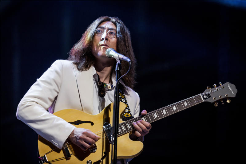 "This Monday, July 15, 2013, photo provided by The Hartman Group shows Reuven Gershon performing ""Come Together"" in the rock musical ""Let It Be"" at the St. James Theater in New York. Gershon and James Fox have some insanely daunting shoes to fill: Every night, they're asked to impersonate John and Paul on Broadway. Gershon and Fox portray, respectively, John Lennon and Paul McCartney in a Fab Four cover band that has taken its concert show, ""Let It Be,"" from London's West End to New York. (AP Photo/The Hartman Group, Chad Batka)"