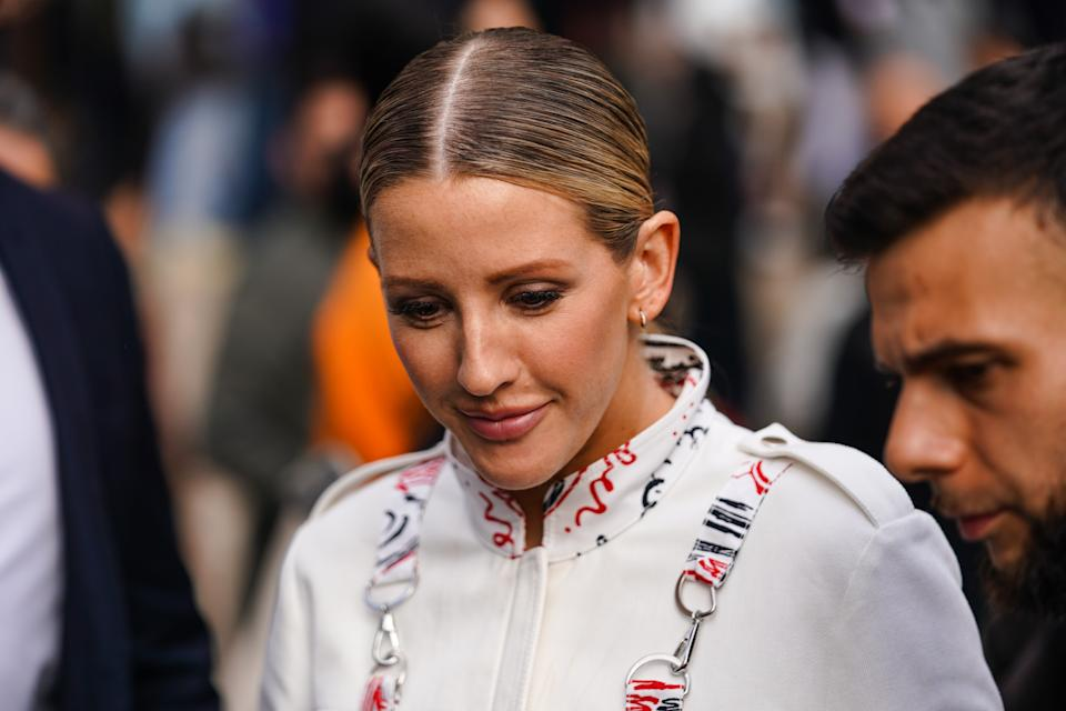 PARIS, FRANCE - SEPTEMBER 30: Ellie Goulding wears earrings, a hi-neck white jacket with red and white print, outside Stella McCartney , during Paris Fashion Week - Womenswear Spring Summer 2020, on September 30, 2019 in Paris, France. (Photo by Edward Berthelot/Getty Images)