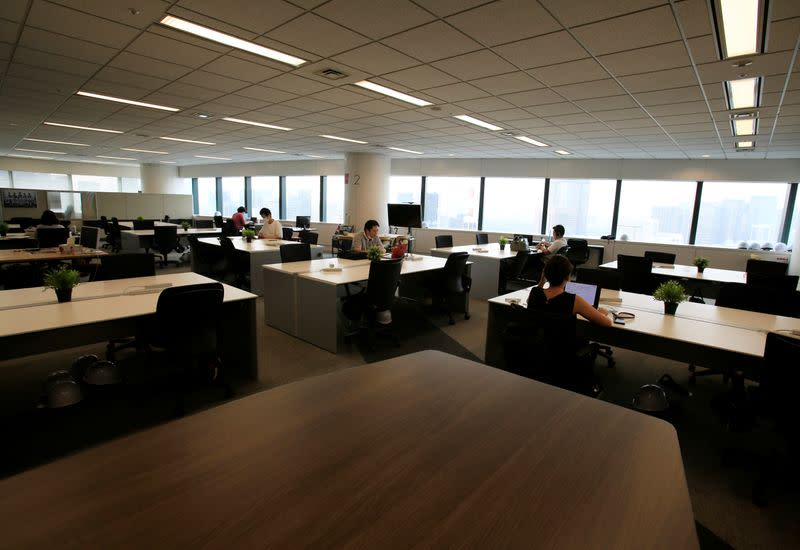 FILE PHOTO: People work in an office where the majority of staff work remotely, amid the coronavirus disease (COVID-19) pandemic at the headquarters of Fujitsu in Tokyo