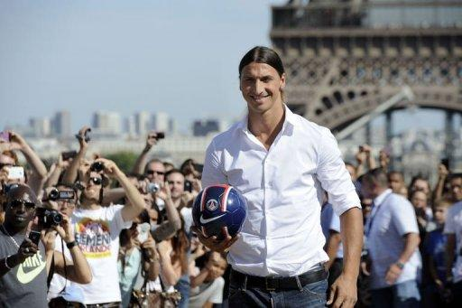 Paris Saint-Germain (PSG) football club's newly recruited Sweden's striker Zlatan Ibrahimovic poses in front of the Eiffel tower in Paris