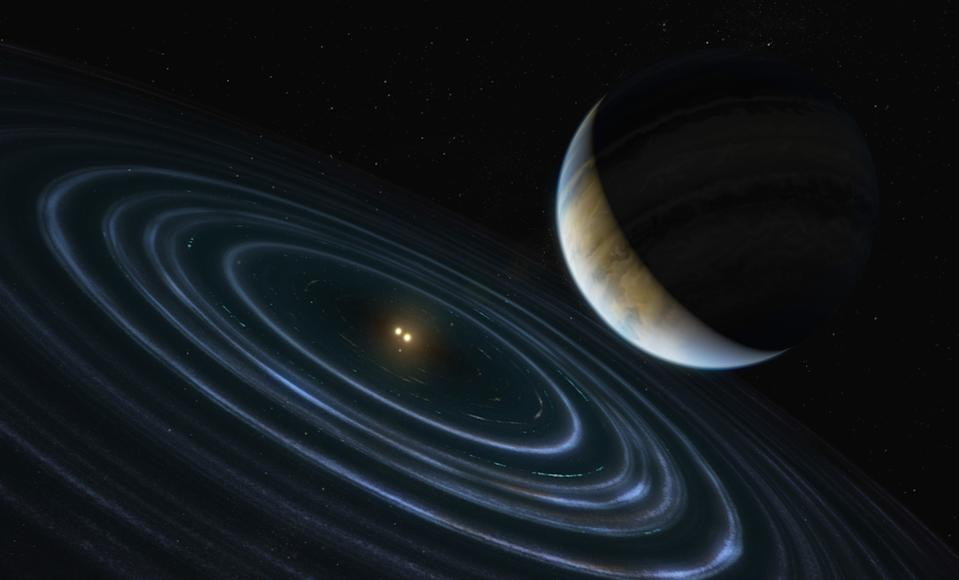 This 11-Jupiter-mass exoplanet called HD106906 b occupies an unlikely orbit around a double star 336 light-years away (Hubble)