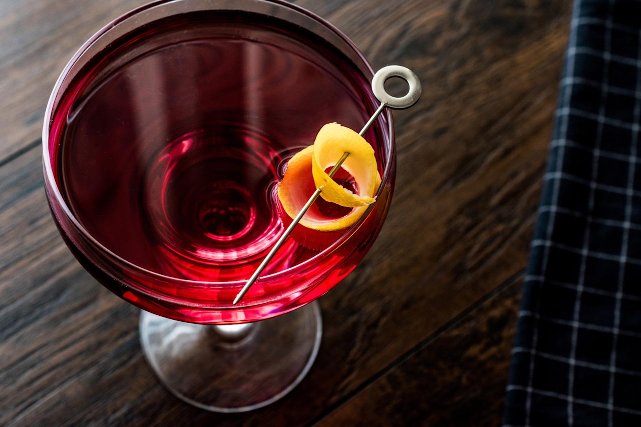 """Christmas wouldn't be the same without this big, bold, and bitter cocktail that relies on whiskey (rye or bourbon both work), Campari, and sweet vermouth. Serve up or on the rocks and garnish with a lemon twist. <a href=""""https://www.epicurious.com/recipes/food/views/boulevardier-51147470?mbid=synd_yahoo_rss"""">See recipe.</a>"""