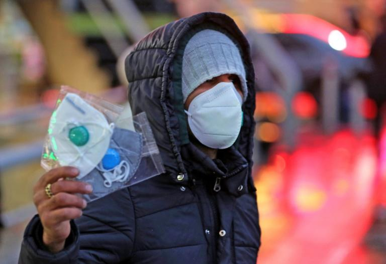 An Iranian street vendor sells protective masks in the capital Tehran