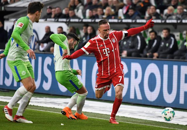 Soccer Football - Bundesliga - VfL Wolfsburg vs Bayern Munich - Volkswagen Arena, Wolfsburg, Germany - February 17, 2018 Bayern Munich's Franck Ribery in action with Wolfsburg's Renato Steffen REUTERS/Fabian Bimmer DFL RULES TO LIMIT THE ONLINE USAGE DURING MATCH TIME TO 15 PICTURES PER GAME. IMAGE SEQUENCES TO SIMULATE VIDEO IS NOT ALLOWED AT ANY TIME. FOR FURTHER QUERIES PLEASE CONTACT DFL DIRECTLY AT + 49 69 650050