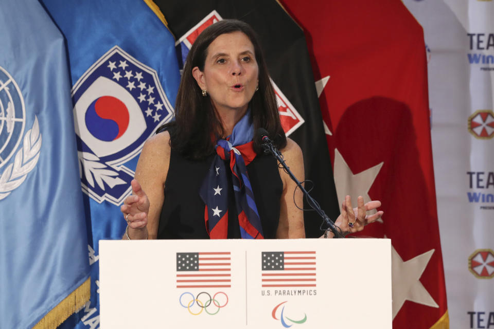 FILE - In this Aug. 1, 2017, file photo, then-U.S. Olympic Committee chief marketing officer Lisa Baird speaks about the Team USA WinterFest for the upcoming 2018 Pyeongchang Winter Olympic Games, at Yongsan Garrison, a U.S. military base in Seoul, South Korea. National Women's Soccer League Commissioner Lisa Baird is out after some 19 months on the job amid allegations that a former coach engaged in sexual harassment and misconduct toward players, a person with knowledge of the situation told The Associated Press. The person spoke to the AP on the condition of anonymity because the move Friday, Oct. 1, 2021 had not been made public.(AP Photo/Lee Jin-man, File)