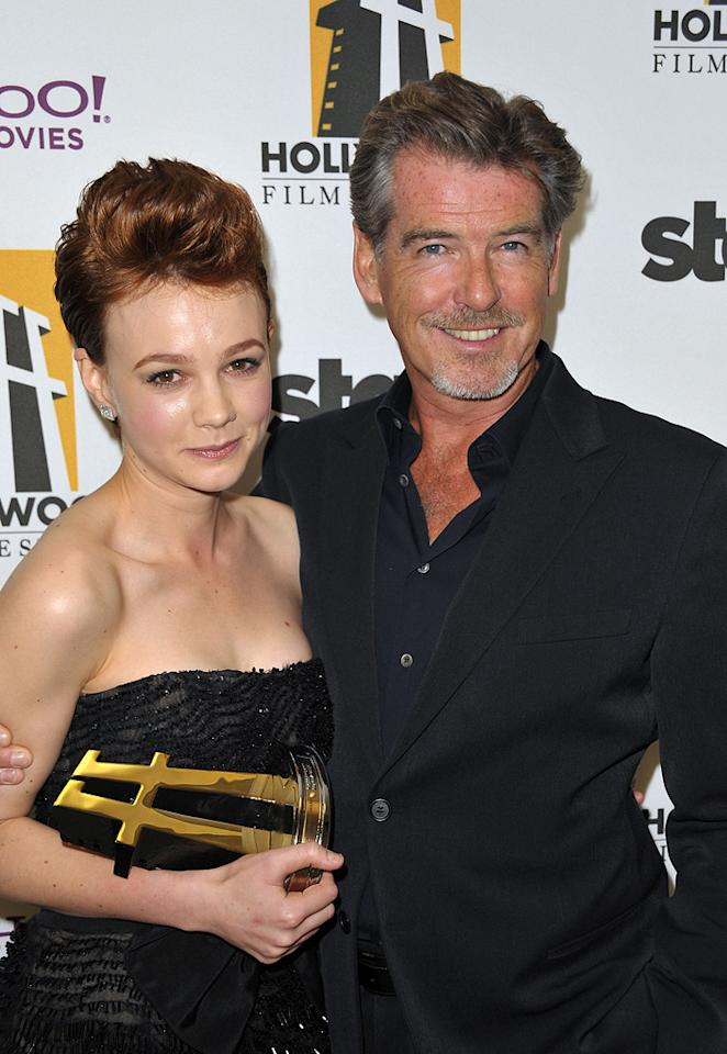 """<a href=""""http://movies.yahoo.com/movie/contributor/1808686699"""">Carey Mulligan</a> and <a href=""""http://movies.yahoo.com/movie/contributor/1800019685"""">Pierce Brosnan</a> at the 13th Annual Hollywood Awards Gala held at the Beverly Hilton Hotel - 10/26/2009"""