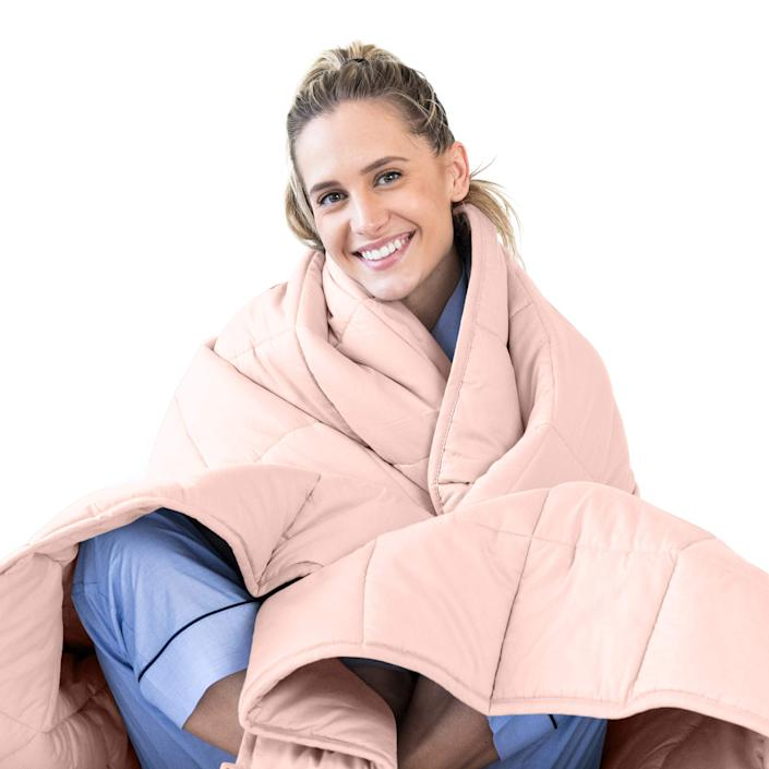 """<strong><h3><a href=""""https://amzn.to/2UjNxeo"""" rel=""""nofollow noopener"""" target=""""_blank"""" data-ylk=""""slk:Queen-Sized Weighted Blanket"""" class=""""link rapid-noclick-resp"""">Queen-Sized Weighted Blanket</a></h3></strong> <br>Recipe for a fire V-Day: Stay in, order Seamless, and get cozy with your main squeeze underneath a calming weighted blanket sized for two.<br><br><strong>LUNA</strong> Adult Weighted Blanket, 15 lbs (Queen), $, available at <a href=""""https://amzn.to/2UjNxeo"""" rel=""""nofollow noopener"""" target=""""_blank"""" data-ylk=""""slk:Amazon"""" class=""""link rapid-noclick-resp"""">Amazon</a><br>"""