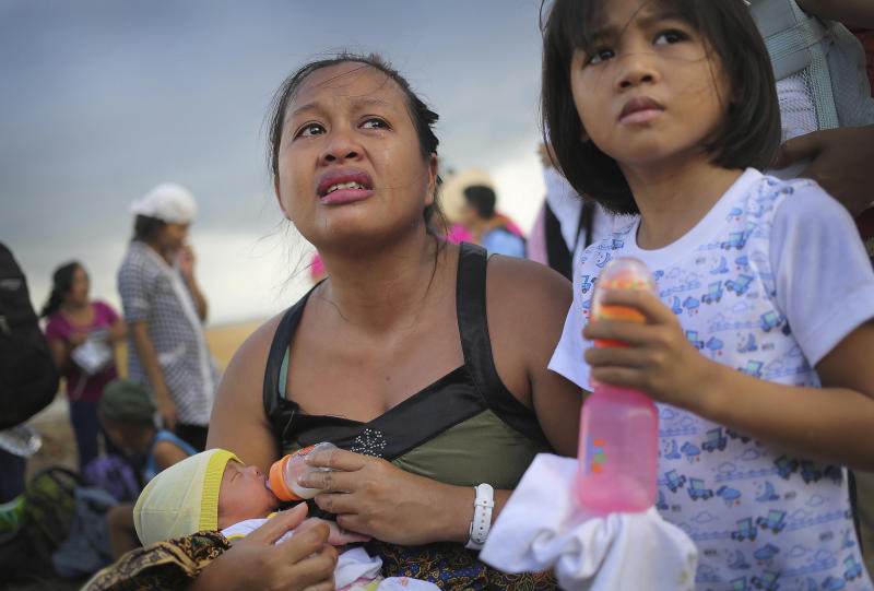 A woman cries as she pleads with military to let her husband through to the front of the queue as they wait for evacuation by C-130 military aircraft Thursday, Nov. 14, 2013 in Tacloban city, Leyte province, central Philippines. Typhoon Haiyan, one of the strongest storms on record, slammed into 6 central Philippine islands on Friday leaving a wide swath of destruction. (AP Photo/Wong Maye-E)