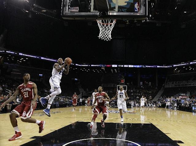 Seton Hall's Fuquan Edwin (23) drives past Oklahoma's Cameron Clark (21) during the first half of a Coaches vs. Cancer NCAA college basketball game on Friday, Nov. 22, 2013, in New York. (AP Photo/Frank Franklin II)