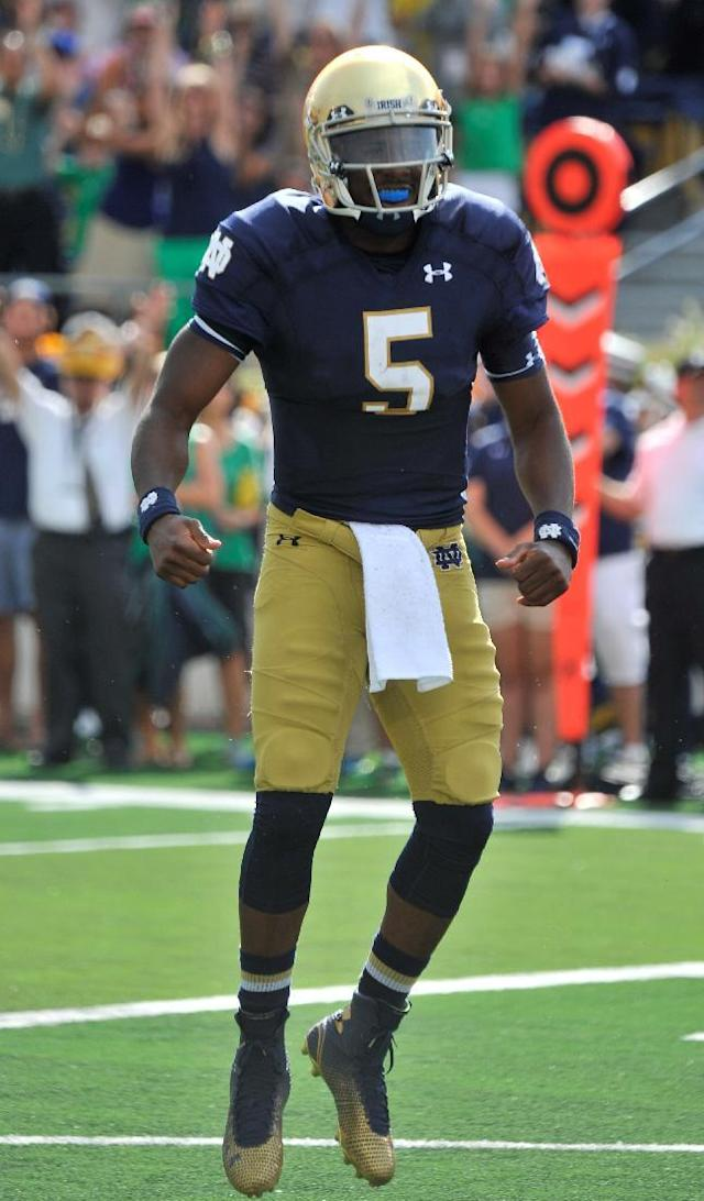 Notre Dame quarterback Evertt Golson reacts after scoring a touchdown during an NCAA college football game with Rice in South Bend, Ind., Saturday, Aug. 30, 2014. (AP Photo/Joe Raymond)