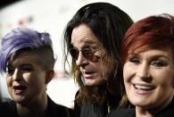 """(L-R) TV personality Kelly Osbourne and her parents, musician Ozzy Osbourne and TV host Sharon Osbourne react at the10th anniversary of """"Classic Rock Roll of Honour"""" awards in Los Angeles, California November 4, 2014. REUTERS/Kevork Djansezian (UNITED STATES - Tags: ENTERTAINMENT ANNIVERSARY)"""