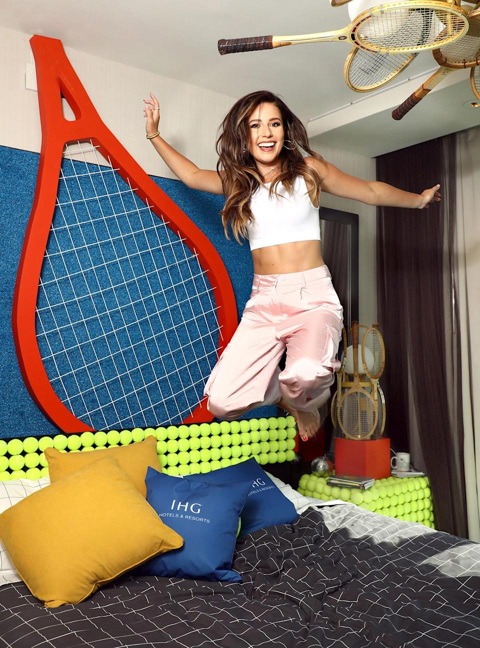 <p>Katie Thurston visits the IHG Hotels & Resorts' Tennis in Wonderland room at the Kimpton Hotel in N.Y.C. on Aug. 31.</p>
