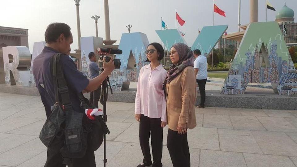 Jamila and her mother Noorhashimah being interviewed in front of the Putrajaya signage. – Pix courtesy of Artjamila