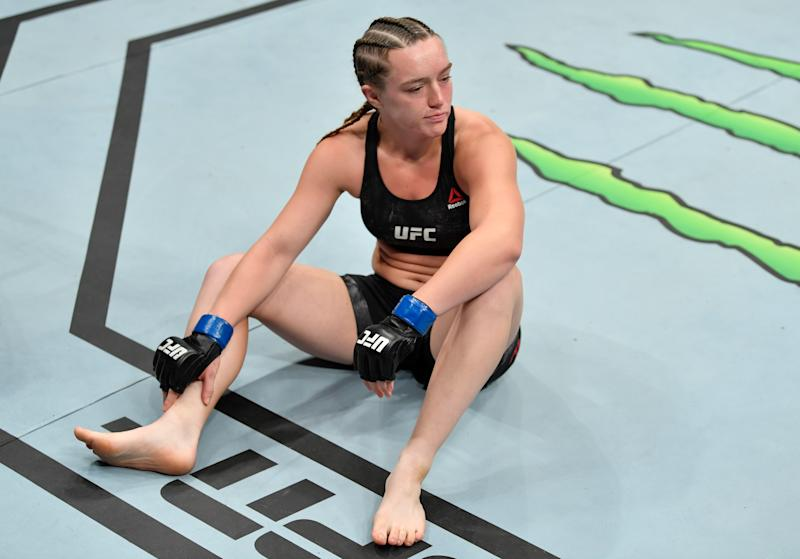 SACRAMENTO, CALIFORNIA - JULY 13: Aspen Ladd reacts after her TKO loss to Germaine de Randamie of the Netherlands in their women's bantamweight bout during the UFC Fight Night event at Golden 1 Center on July 13, 2019 in Sacramento, California. (Photo by Jeff Bottari/Zuffa LLC/Zuffa LLC via Getty Images)