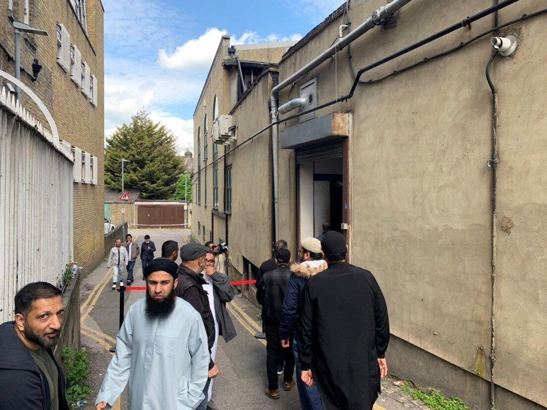 """Worshippers arrive for Friday Prayers at Seven Kings Mosque in Ilford following an incident on Thursday when a """"masked"""" gunman entered the building during Ramadan prayers before discharging a firearm outside. (PA Images)"""