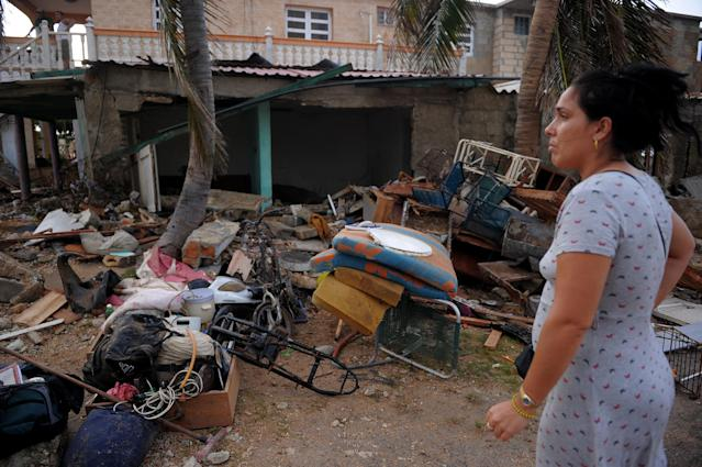 <p>Cubans recover their belongings after the passage of Hurricane Irma, in Cojimar neighborhood in Havana, on Sept. 10, 2017. (Photo: Yamil Lage/AFP/Getty Images) </p>