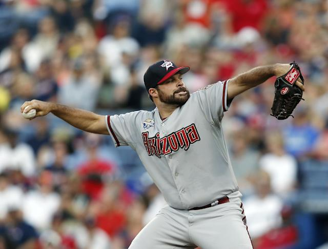 Arizona Diamondbacks starting pitcher Josh Collmenter works in the first inning of a baseball game against the Atlanta Braves in Atlanta, Friday, July 4, 2014. (AP Photo/John Bazemore)