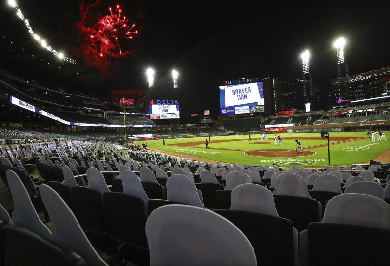 About 1,500 cardboard cutouts of fans are in seats as the Atlanta Braves defeat the Tampa Bay Rays 7-4 in a baseball game, the Braves' home-opener, Wednesday, July 29, 2020, in Atlanta. (Curtis Compton/Atlanta Journal-Constitution via AP)