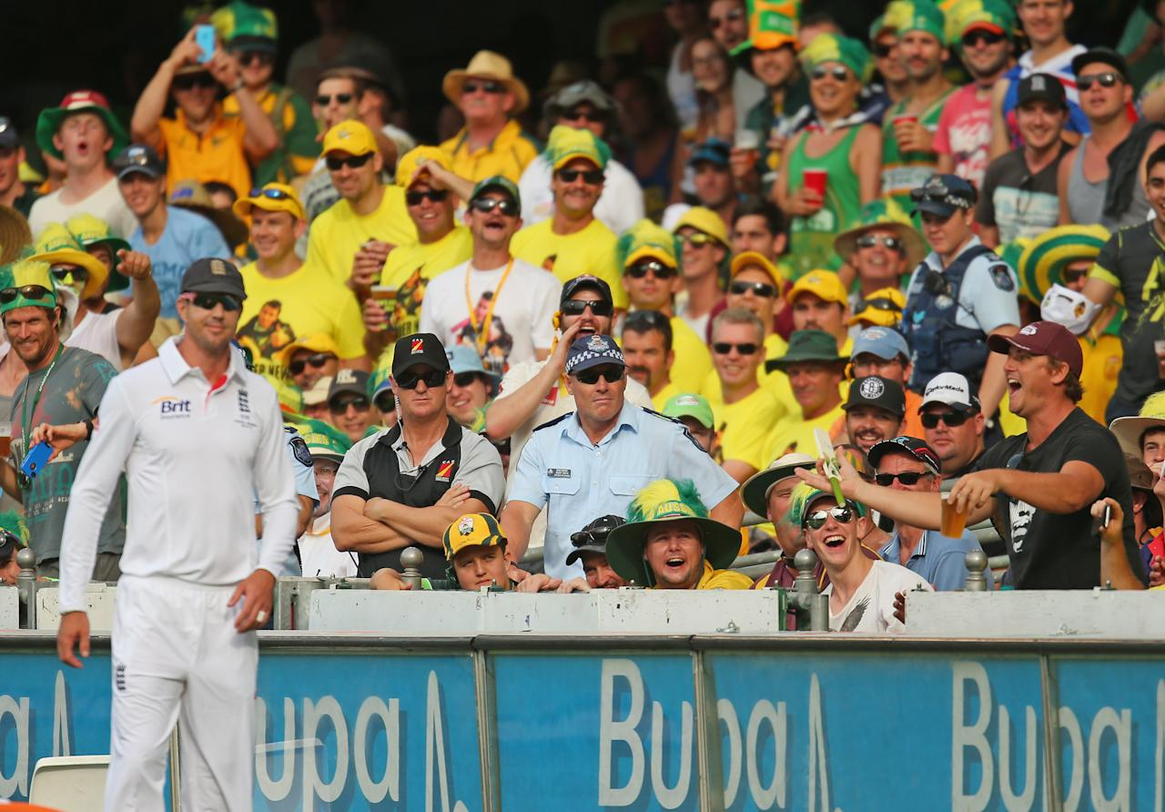 BRISBANE, AUSTRALIA - NOVEMBER 22:  Kevin Pietersen of England reacts after a spectator (R) refused to let Pietersen sign his bat during day two of the First Ashes Test match between Australia and England at The Gabba on November 22, 2013 in Brisbane, Australia.  (Photo by Scott Barbour/Getty Images)