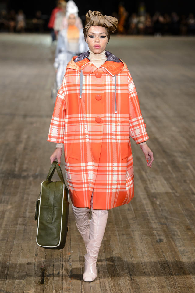 <p><i>A model in an orange and white plaid coat. (Photo: ImaxTree) </i></p>