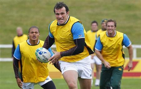South African Springbok rugby players Bismark du Plessis and Juan de Jongh train at a practice session in Taupo