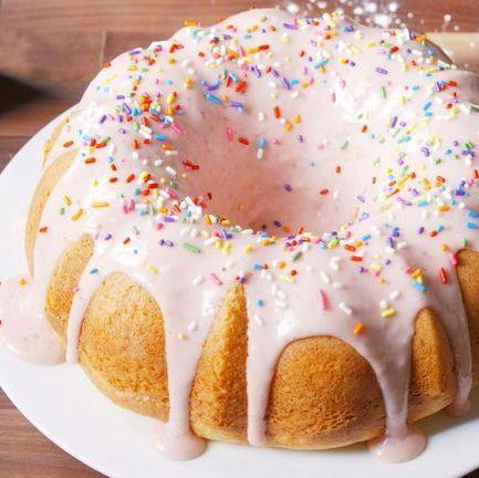 """<p>No one can deny the allure of a good glazed doughnut. Forget breaking out the heavy-bottomed pot and the fry oil—this easy cake checks all the same boxes. Thank us later. </p><p>Get the <a href=""""https://www.delish.com/uk/cooking/recipes/a29887440/donut-cake-recipe/"""" rel=""""nofollow noopener"""" target=""""_blank"""" data-ylk=""""slk:Glazed Doughnut Cake"""" class=""""link rapid-noclick-resp"""">Glazed Doughnut Cake</a> recipe.</p>"""