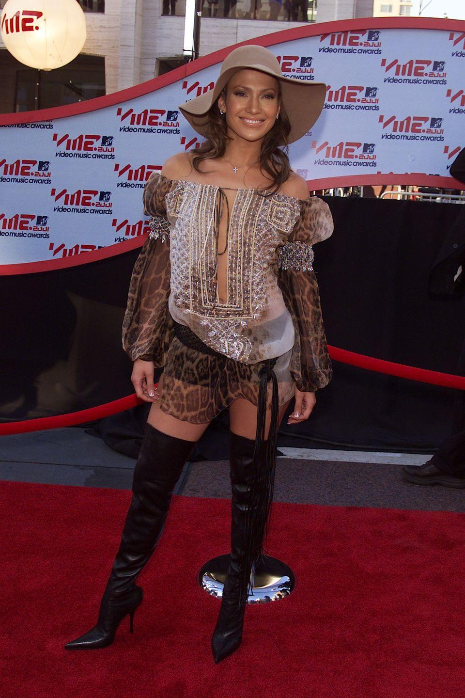 <p>This one was a practical look: J.Lo's sun-hat and thigh-high boots eliminated any need for SPF.</p>