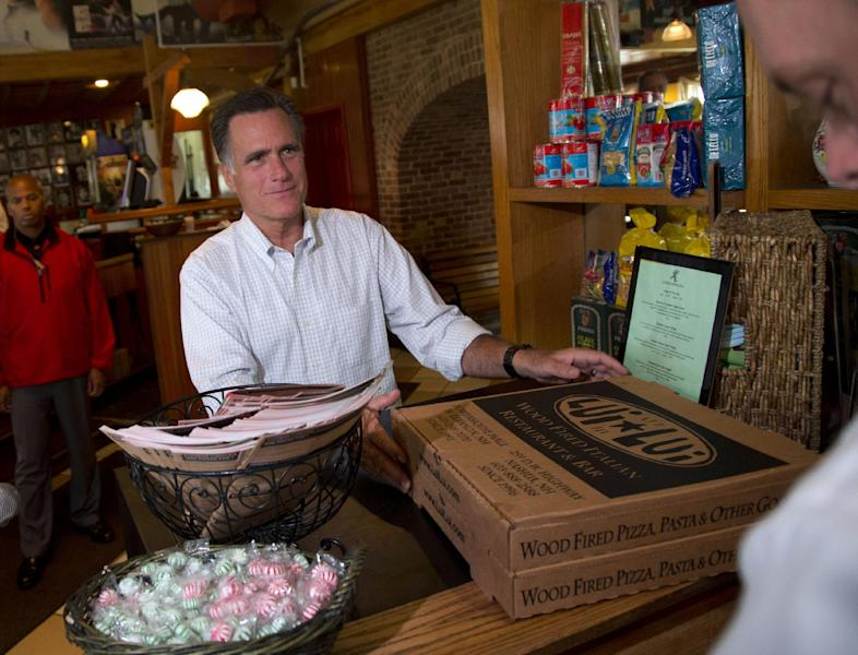 Republican presidential candidate, former Massachusetts Gov. Mitt Romney picks up his order after stopping at Lui-Lui Restaurant on Wednesday, Sept. 5, 2012, in West Lebanon, N.H. (AP Photo/Evan Vucci)