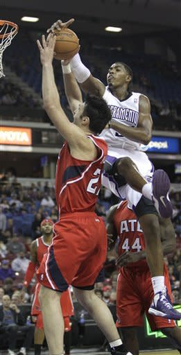 Atlanta Hawks center Zaza Pachulia, left, of Georgia, is fouled by Sacramento Kings forward Jason Thompson during the first half of an NBA basketball game in Sacramento, Calif., Friday, Nov. 16, 2012. (AP Photo/Rich Pedroncelli)