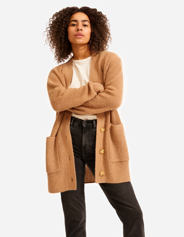 "Even though summer is on the horizon, everyone is really just swaddling themselves in cozy fabrics for the time being. This oversize cardigan is comfortable enough for the couch but cute enough for the grocery store. $128, Everlane. <a href=""https://www.everlane.com/products/womens-oversized-alpaca-cardigan-biscuit?collection=womens-sweaters"" rel=""nofollow noopener"" target=""_blank"" data-ylk=""slk:Get it now!"" class=""link rapid-noclick-resp"">Get it now!</a>"