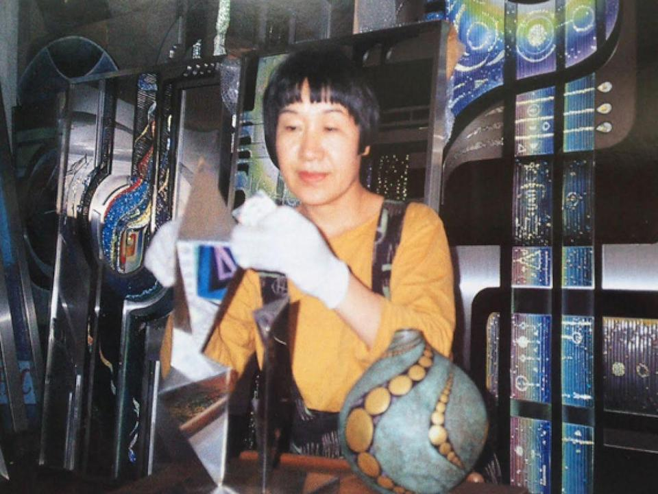 """Toshiko Tanaka, then 30 years old, works in her art studio. After surviving the atomic bombing of Hiroshima as a child, Toshiko became an artist and has created large enameled murals for more than 50 years. <span class=""""copyright"""">Photo: Courtesy of Toshiko Tanaka. </span>"""