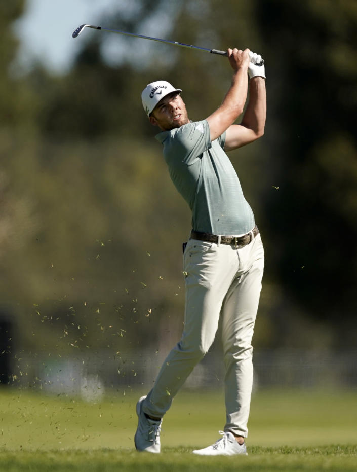 Sam Burns hits his second shot on the third hole during the final round of the Genesis Invitational golf tournament at Riviera Country Club, Sunday, Feb. 21, 2021, in the Pacific Palisades area of Los Angeles. (AP Photo/Ryan Kang)