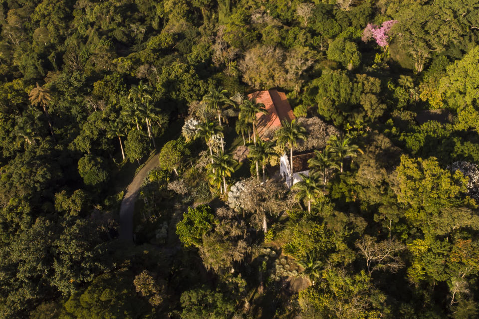 Aerial View of Roberto Burle Marx's former home, which was elected today as a World Heritage Site by the United Nations Educational, Scientific and Cultural Organization, UNESCO, in Rio de Janeiro, Brazil, Tuesday, July 27, 2021. The site features more than 3,500 species of plants native to Rio and is considered a laboratory for botanical and landscape experimentation. (AP Photo/Mario Lobão)